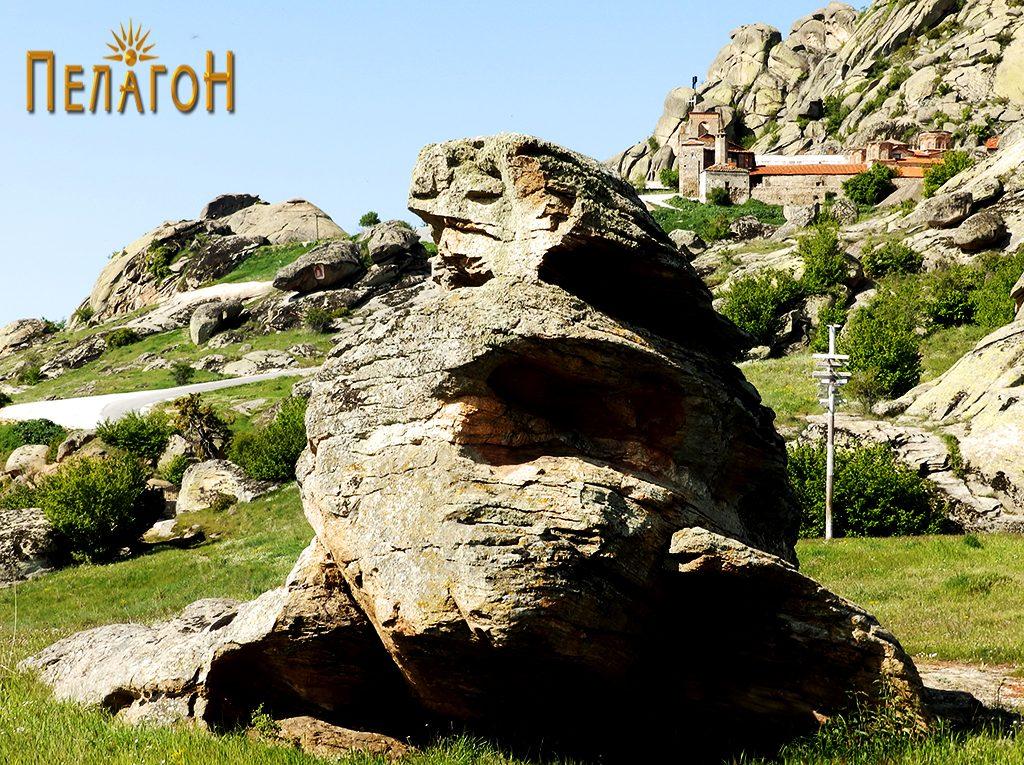 Централната култна карпа на Гумење од југ со манастирот во позадина